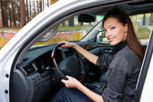 Smiling woman sits in the new car — Stock Photo