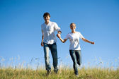 Young couple running — Stock Photo