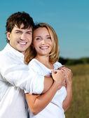 Happy beautiful couple on nature — Stock Photo