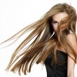 Teen girl shaking head with long hair — ストック写真