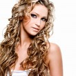 Stock Photo: Beautiful womwith long curly hairs
