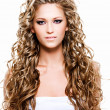 Beautiful woman with long curly hairs — Stock Photo #4899987