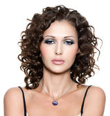 Beautiful woman with fashion makeup and curly hair — Stock Photo