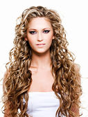 Beautiful woman with long curly hairs — Foto de Stock