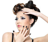 Woman with stylish hairstyle and black nails — Stock Photo