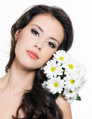 Face of woman with bouquet of flowers — Stock Photo