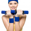Woman doing fitness exercise with dumbbells — Stock Photo