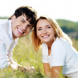 Happy beautiful couple on nature — Stock Photo #5188898