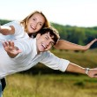 Happy beautiful couple on nature — Stock Photo
