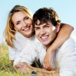 Foto Stock: Happy beautiful couple on nature