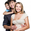 Happy young family with pretty child — Stok fotoğraf