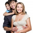 Happy young family with pretty child — Stock fotografie