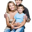 Happy young family with pretty child — Stockfoto