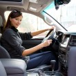 Young woman in the new car — Foto Stock