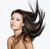 Sensual young woman with creative hairstyle — Stock Photo
