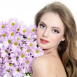 Woman with spring flowers — Stock Photo