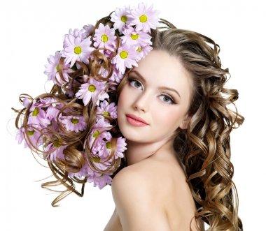 Spring flowers in hair of woman