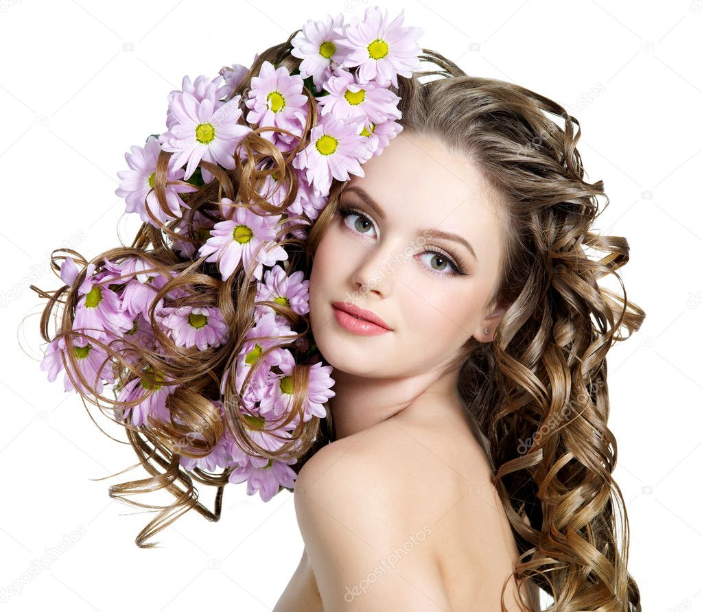 Spring flowers in beautiful long hair of young woman - white background  Stock Photo #5205463