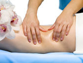 Part of female body with massage — Stock Photo