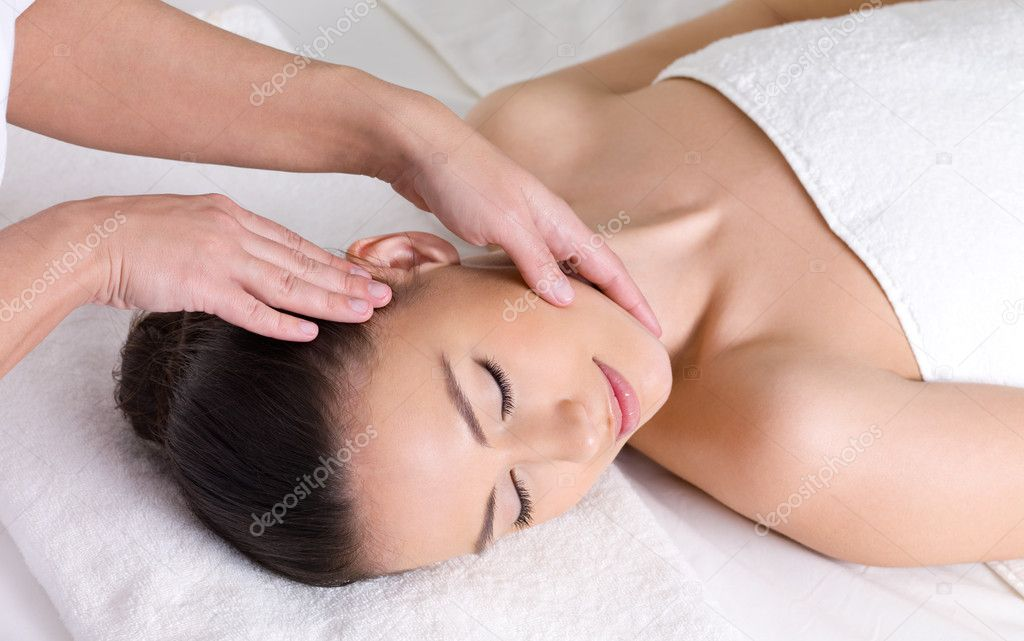 Young woman having massage for the skin of her beautiful face  Stock Photo #5303622