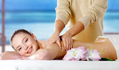 Smiling girl getting spa massage — Stock Photo