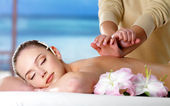 Woman on spa massage for back — Stock Photo