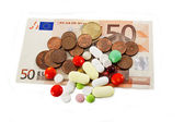 Euro and tablets — Stockfoto