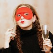 Portrait of a girl in a mask with a glass of wine — Stock Photo #4585119