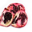 Pomegranate divided into parts — Stock Photo