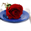 Stock Photo: Red rose on plate