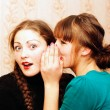 Woman telling secrets — Stock Photo #5105906
