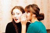 Woman telling secrets — Stock Photo