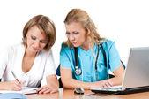 Doctors with laptop — Stock Photo