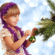 Girl with bauble - Stock Photo
