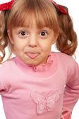 Girl showing tongue — Stock fotografie