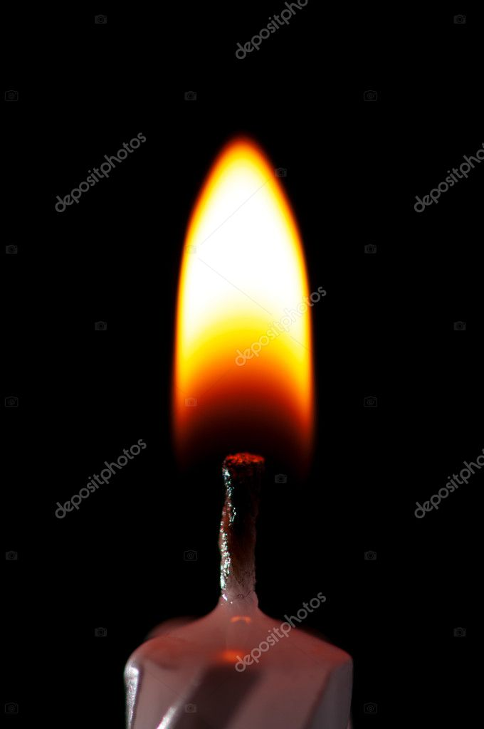 Close-up of burning candle isolated on black background — Stock Photo #4887345