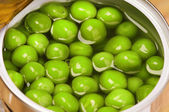 Tin can with green peas — Stok fotoğraf