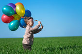 Child with balloons — 图库照片