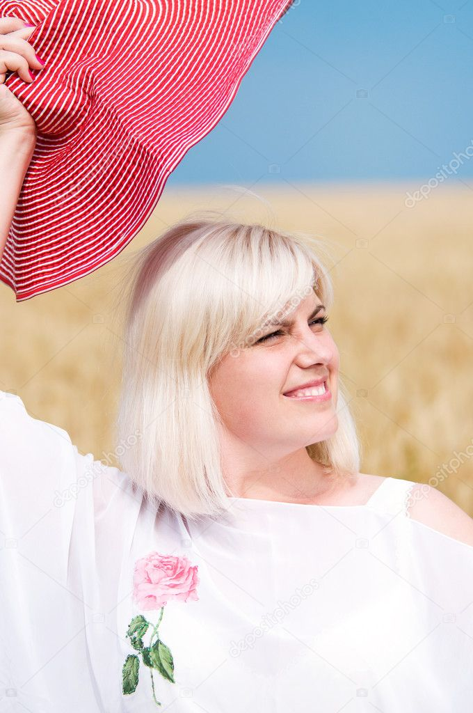 Beautiful woman with hat in wheat meadow on sunny day  Stock Photo #5271556