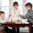 Stock Photo: Twin brothers playing chess game