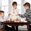 Twin brothers playing chess game - Stock Photo