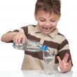 Boy with a bottle of water — Stock Photo