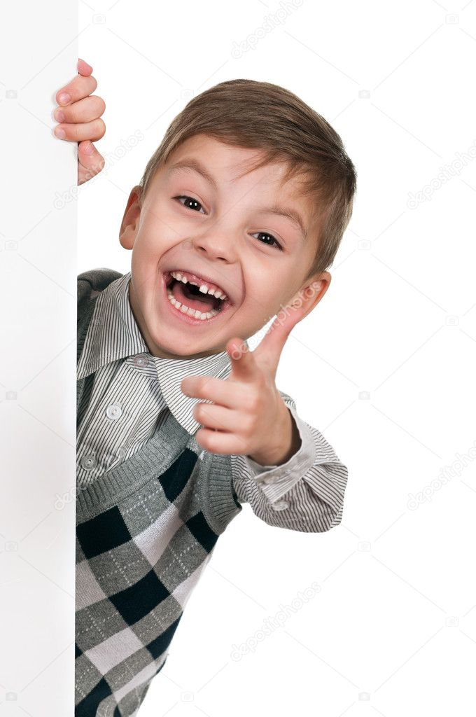 Smiling little boy holding empty white board — Stock Photo #5356639