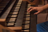 Organist in action — Stock Photo