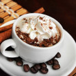 Stock Photo: Cup of coffee with cream and cinnamon