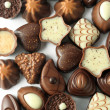 Collection of beautiful delicious chocolate candies isolated — Stock Photo