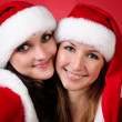 Two girl friends in christmass costumes on white. — Stock Photo #3926511