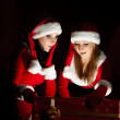 Foto Stock: Sexual girls in Christmas clothes .