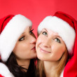 Two girl friends in christmass costumes — Stock Photo #3932441