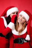 Wo happy young Santa girl talking — Stock Photo